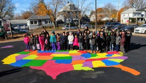 "(Peter Hvizdak New Haven Register) Savin Rock Community School in West Haven, Conn. holds a ribbon-cutting for its ""peaceful playground"" Wednesday, November 20, 2013. The playground  has designs and templates painted on the school's blacktop playground for use during recess activities and games. The initiative was paid for and designs painted by the vertical Church in West Haven."